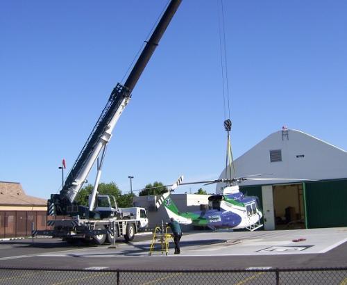 Crane Hoisting St. Mary's helicopter